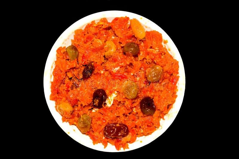 O halwa de Gajar é cenoura baseou o pudim feito com khya, leite, amêndoa, pistache fotografia de stock royalty free
