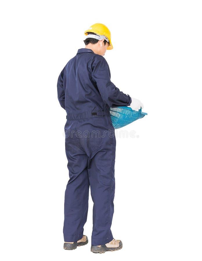 O Hod ou a parte superior da posse do trabalhador novo deram forma à cesta fotografia de stock