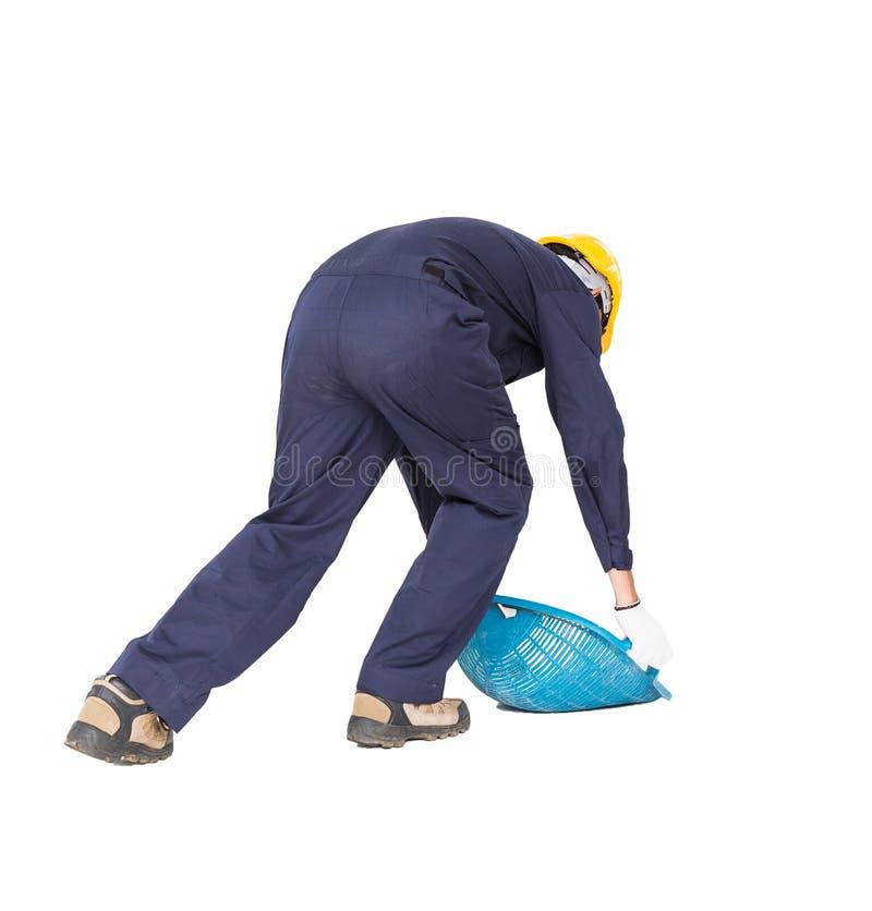 O Hod ou a parte superior da posse do trabalhador novo deram forma à cesta imagens de stock
