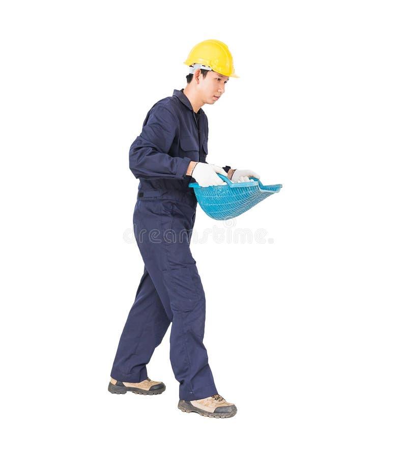 O Hod ou a parte superior da posse do trabalhador novo deram forma à cesta fotos de stock