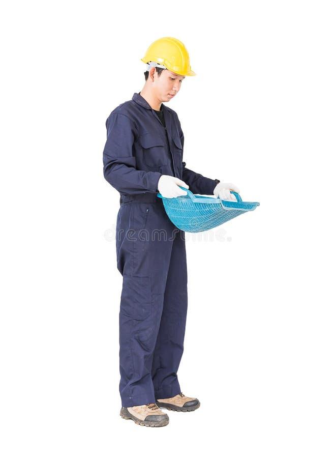 O Hod ou a parte superior da posse do trabalhador novo deram forma à cesta foto de stock royalty free