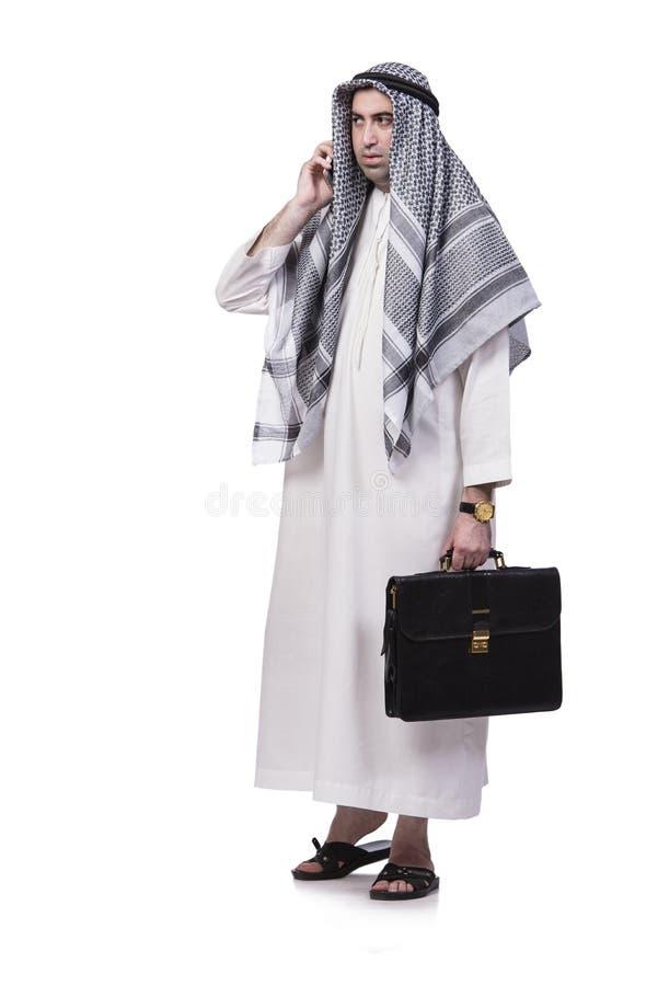 O homem árabe com seu telefone celular isolado no branco fotos de stock