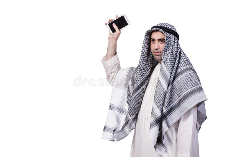 O homem árabe com seu telefone celular isolado no branco imagem de stock royalty free