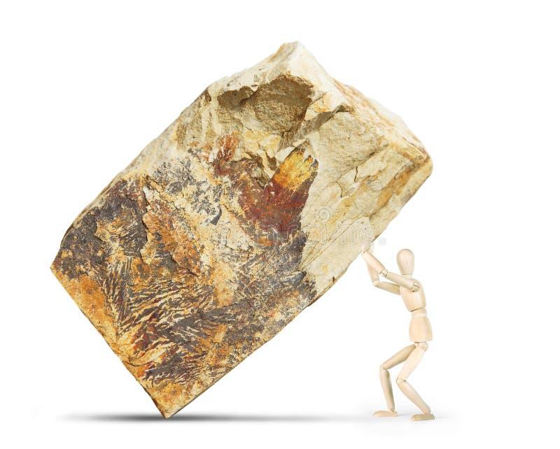 O homem aumenta acima uma rocha enorme fotografia de stock