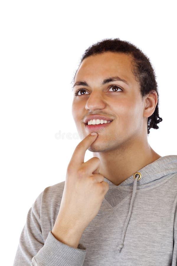 O homem colorido preto novo olha feliz no futuro fotos de stock royalty free