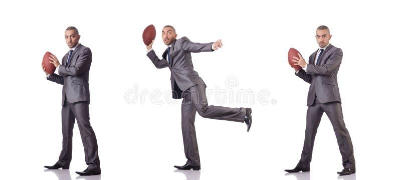 O homem com a bola do futebol americano isolada no branco imagens de stock royalty free