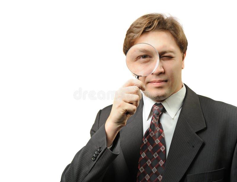 O homem com um magnifier foto de stock royalty free