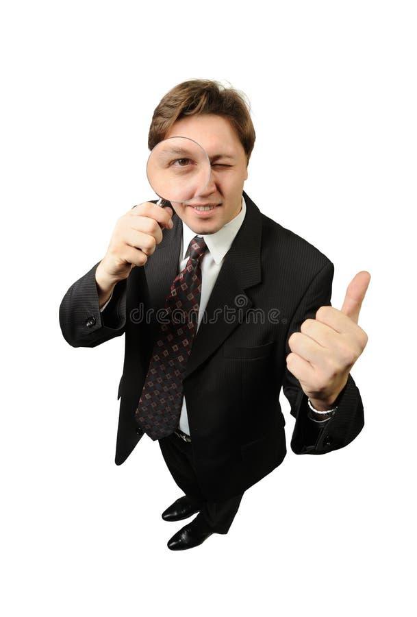 O homem com um magnifier fotografia de stock
