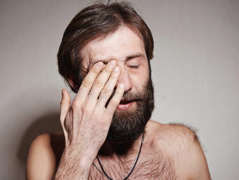 O homem com uma barba grande e os bigodes fotografia de stock