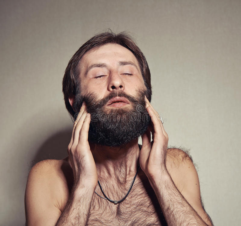 O homem com uma barba grande e os bigodes fotografia de stock royalty free