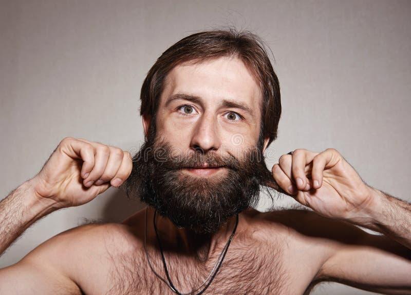 O homem com uma barba grande e os bigodes foto de stock royalty free