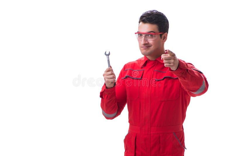 O homem considerável novo com a chave isolada no branco imagem de stock royalty free