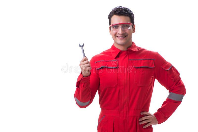 O homem considerável novo com a chave isolada no branco imagens de stock royalty free