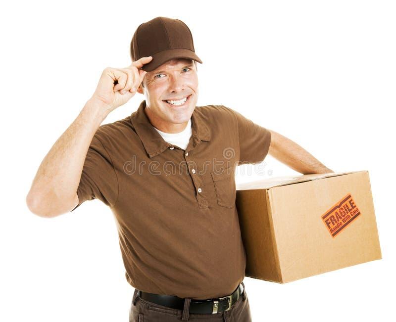 O homem de entrega polido derruba o chapéu fotografia de stock royalty free
