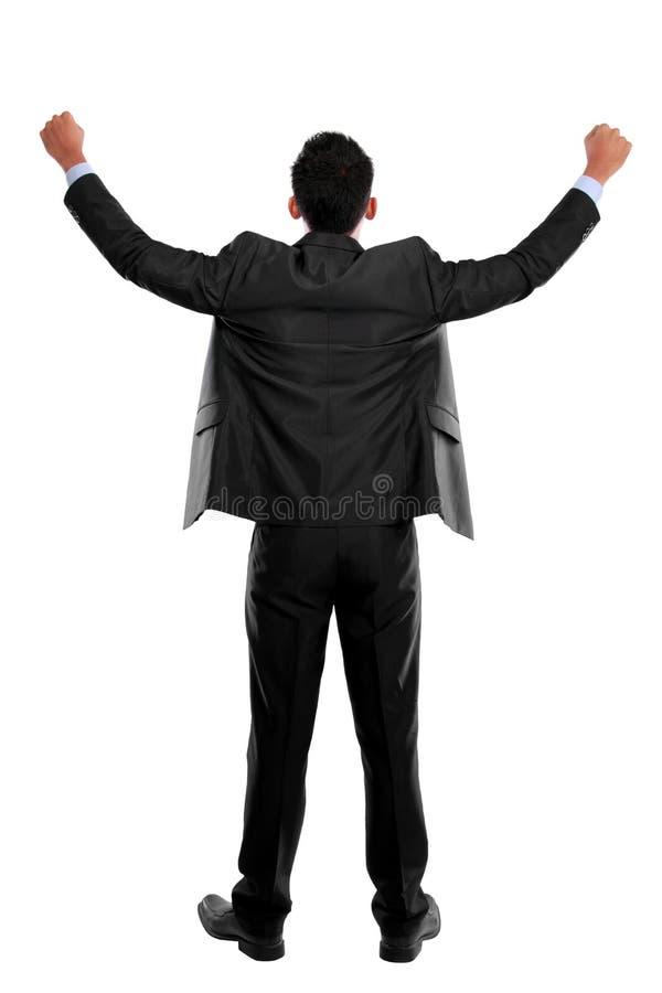 O homem de negócio com braços aumentou no sucesso - isolado no branco foto de stock