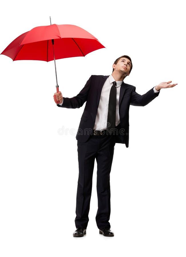 O homem de negócio com guarda-chuva verific a chuva imagem de stock royalty free