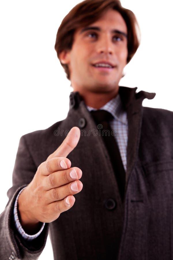 O homem de negócio considerável, arma prolongado para o aperto de mão imagem de stock royalty free