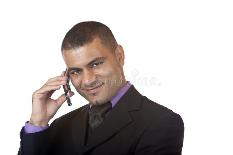 O homem de negócio faz a chamada telefónica fotografia de stock