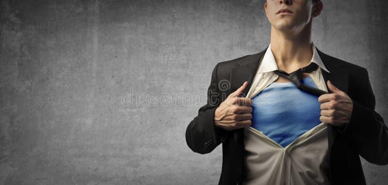 O homem de negócio gosta do superman imagens de stock royalty free