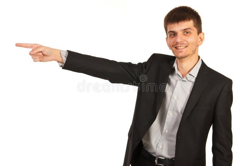 O homem de negócio indica ao lado fotos de stock royalty free