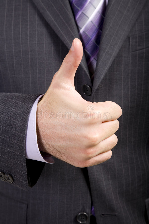 O homem de negócio oferece o Thumbs-Up foto de stock