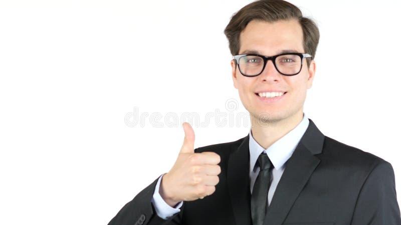 O homem de negócio principal alegre que mostra os polegares levanta o sinal do sucesso foto de stock royalty free