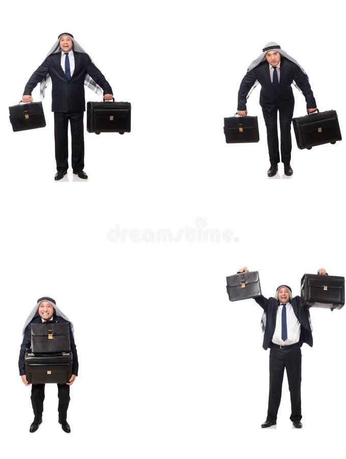 O homem de negócios árabe com a mala de viagem isolada no branco imagem de stock royalty free
