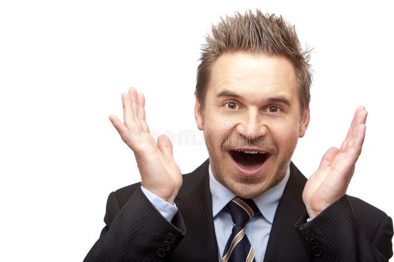 O homem de negócios é positivo surpreendido imagem de stock