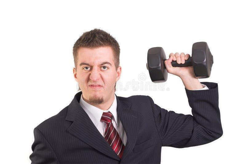 O homem de negócios é weightlifting imagens de stock