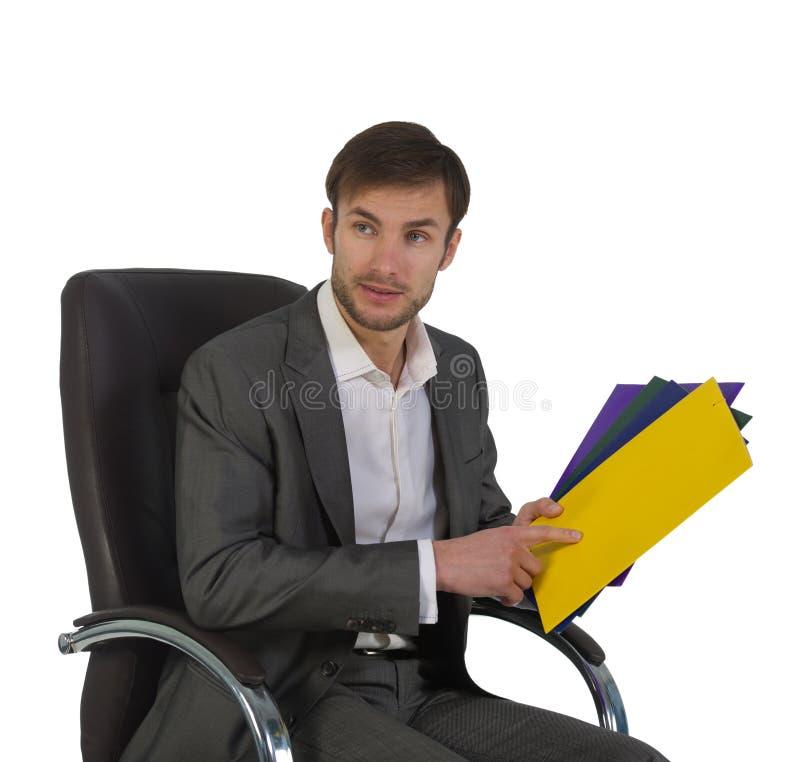 Download O Homem De Negócios No Escritório Senta-se Em Uma Cadeira Imagem de Stock - Imagem de isolado, original: 29831003