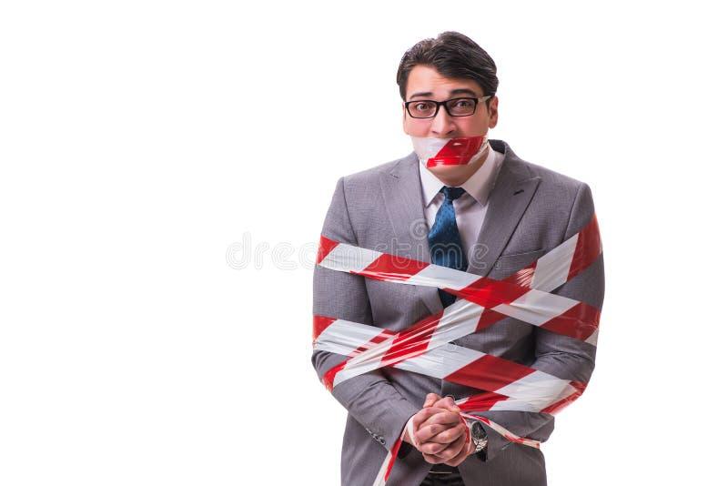 O homem de negócios amarrado pela fita isolada no branco imagem de stock