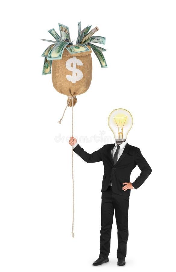 O homem de negócios atrai o dinheiro com suas ideias imagens de stock royalty free