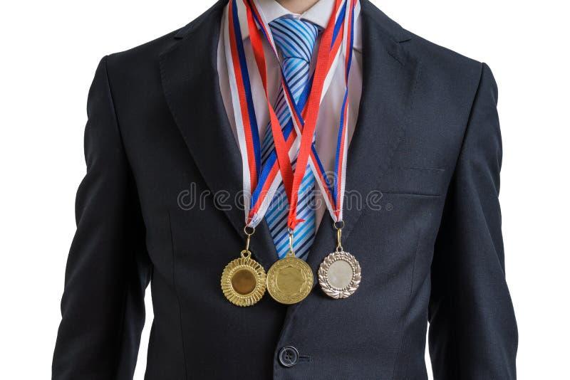 O homem de negócios bem sucedido concedido está vestindo muitas medalhas Isolado no branco fotos de stock royalty free