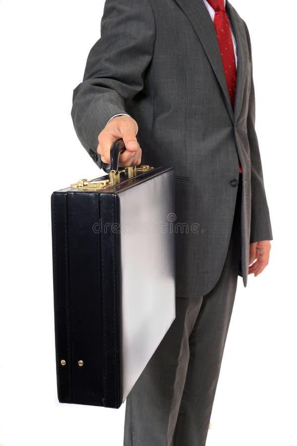 O homem de negócios cede a mala de viagem imagens de stock
