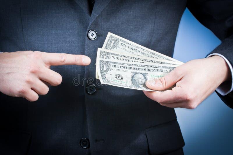 O homem de negócios com dólares em sua mão, conceito para o negócio e ganha o dinheiro fotografia de stock royalty free