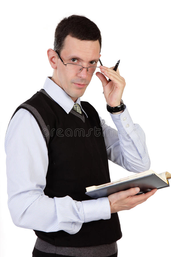 O homem de negócios com o registro diário fotografia de stock