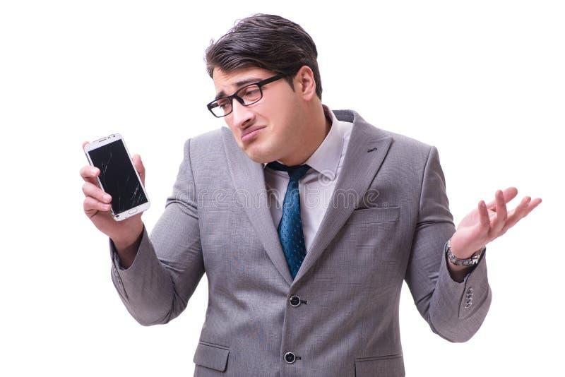 O homem de negócios com o telefone celular isolado no branco imagem de stock royalty free