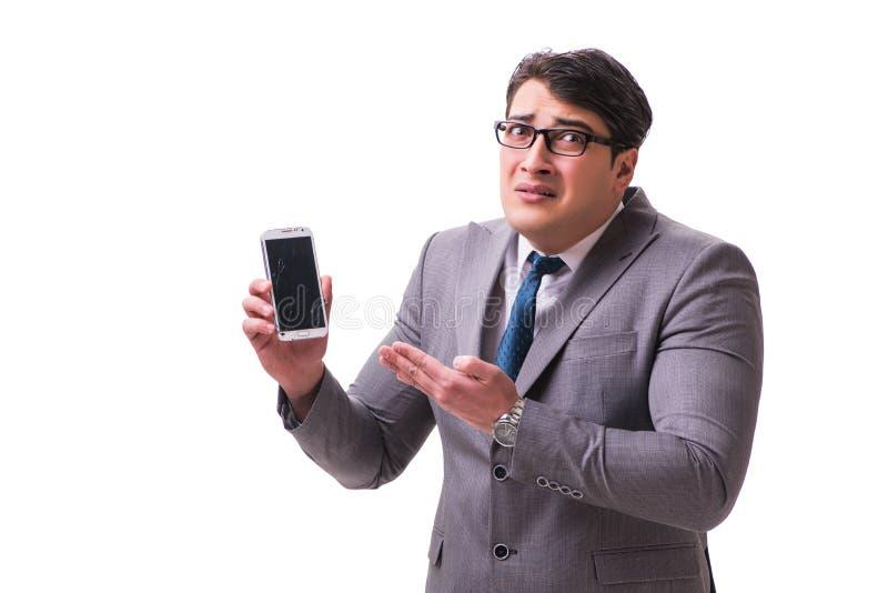 O homem de negócios com o telefone celular isolado no branco imagens de stock royalty free