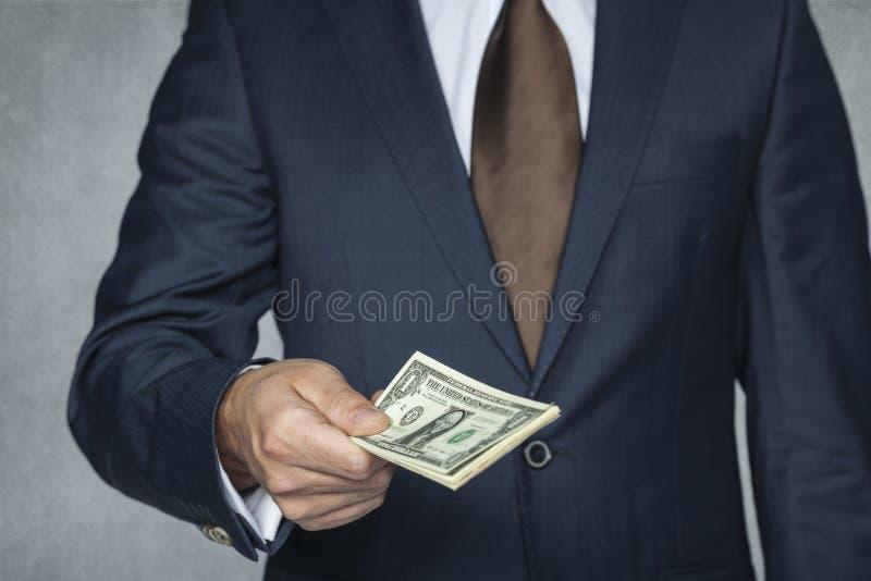 O homem de negócios dá o dinheiro fotografia de stock royalty free