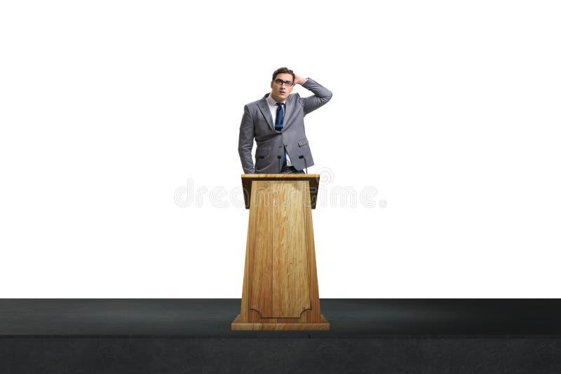 O homem de negócios do homem que faz o discurso na tribuna no conceito do negócio imagem de stock royalty free