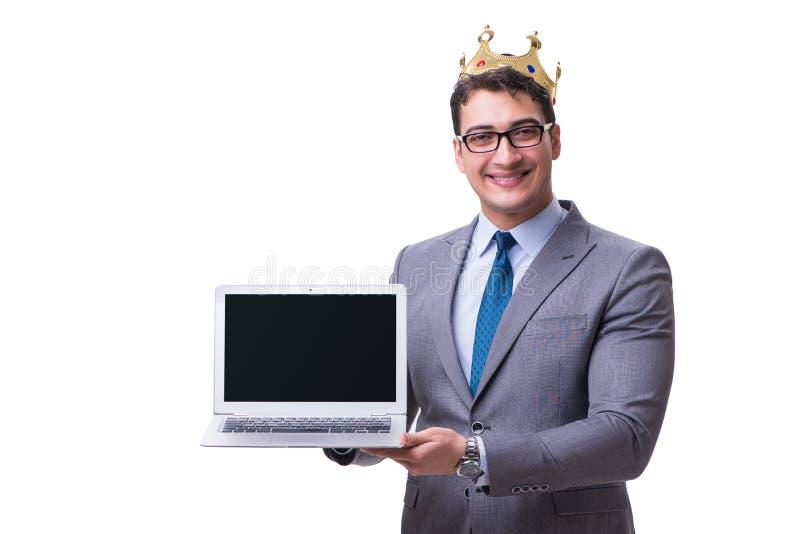 O homem de negócios do rei que mantém um portátil isolado no fundo branco fotos de stock royalty free