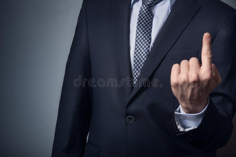 O homem de negócios em pontos de um terno acima fotografia de stock