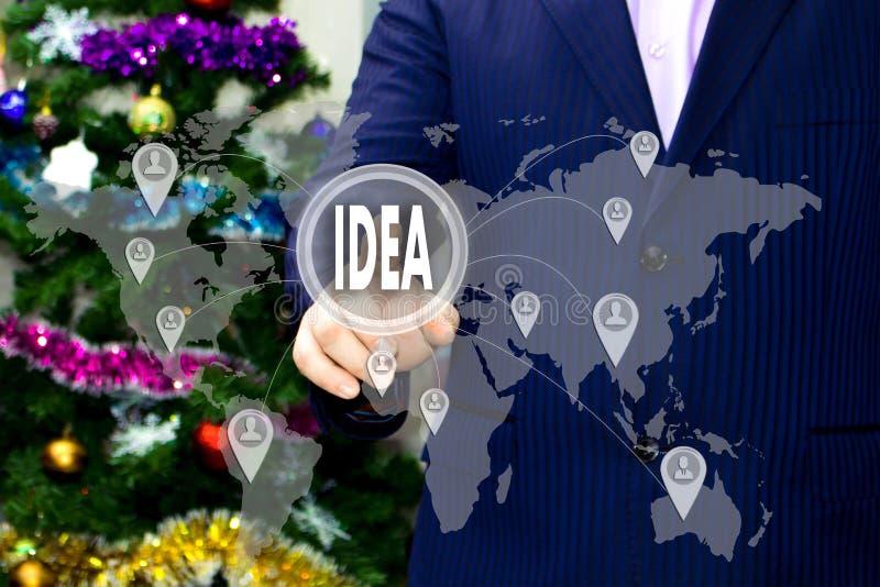O homem de negócios escolhe a IDEIA no tela táctil imagem de stock royalty free