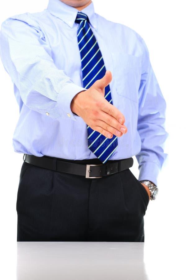 O homem de negócios está dando um aperto de mão imagem de stock royalty free