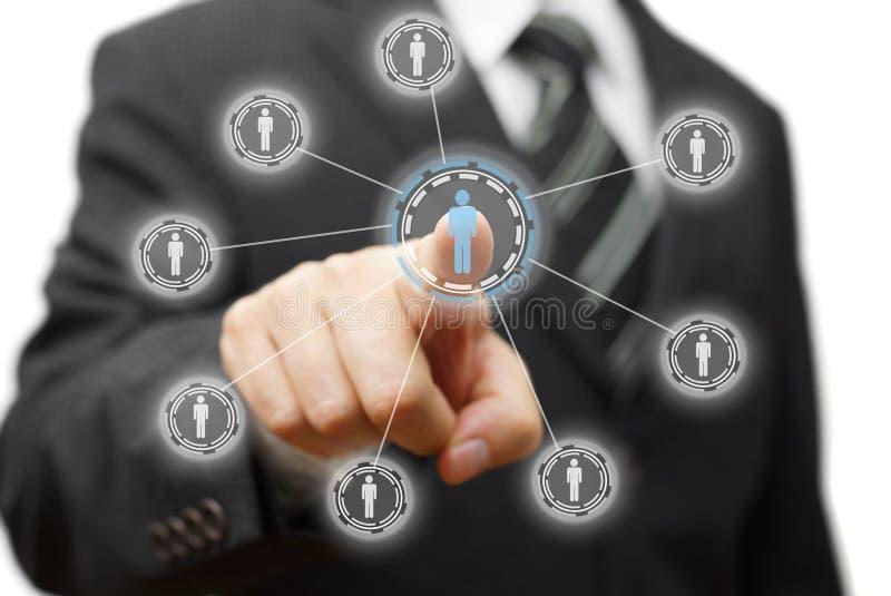 O homem de negócios está pressionando a pessoa virtual, conceito da gestão, st fotos de stock