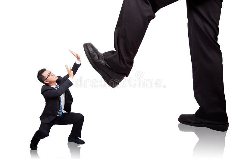 O homem de negócios implora foto de stock