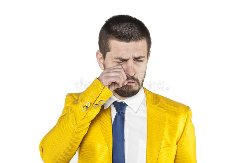 O homem de negócios limpa rasgos imagem de stock