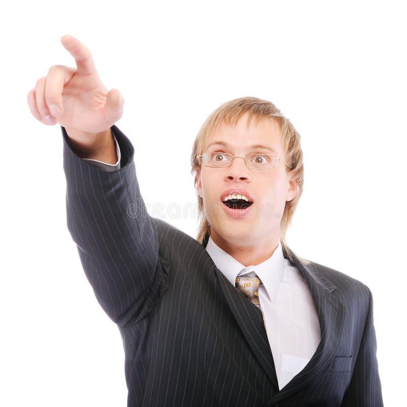 O homem de negócios mostra o forefinger e é surpreendido fotos de stock royalty free
