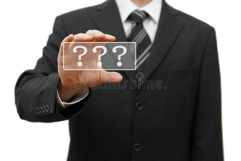 O homem de negócios mostra pontos de interrogação fotografia de stock