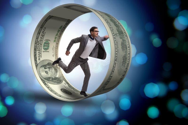 O homem de negócios na roda do hamster que persegue dólares foto de stock royalty free